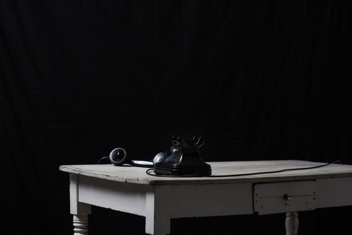 Black Telephone on a White Table